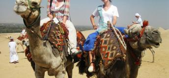 Students camel back riding in Egypt.