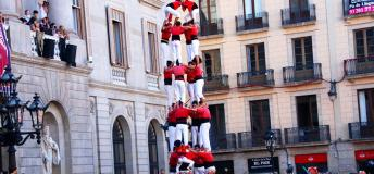Castellers practicing the time-honored tradition of building human towers.