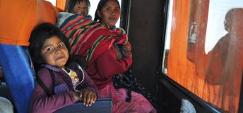 Bolivian Mother Commuting Home with her Kids After a Day in La Paz
