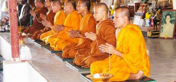 Monks praying in a Thai temple.