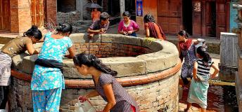 People fetching water from a well inNepal