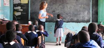Volunteer teacher with student in Africa