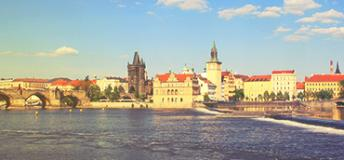 Historical building seen across a river in Czech Republic.