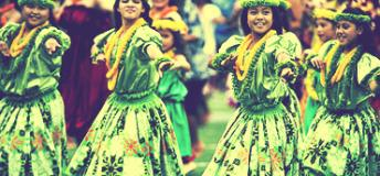 Children dancing in Hawaii dressed in traditional clothing