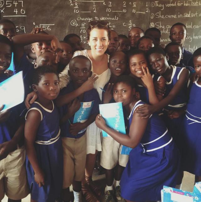 Volunteer teacher with local students in Ghana