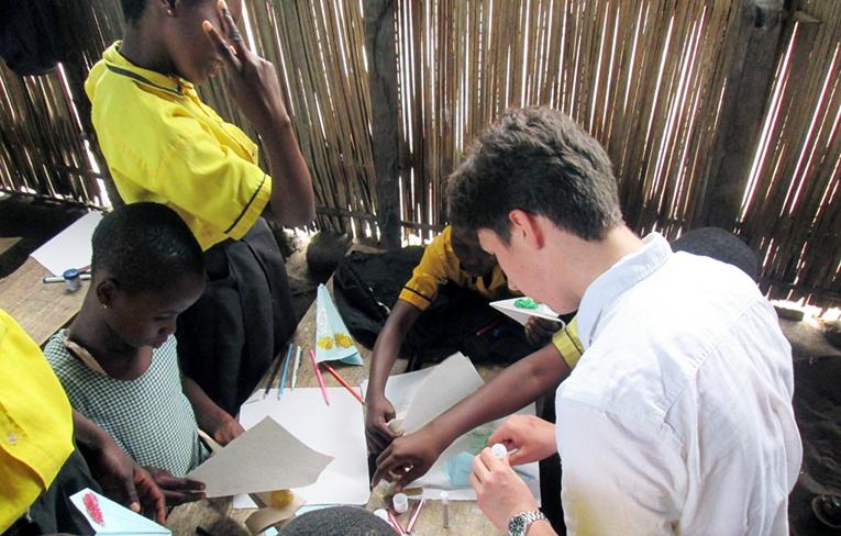 Volunteer making crafts with kids in Ghana