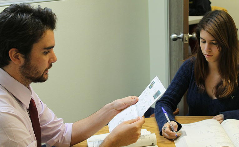 A tutor working one-on-one with a student