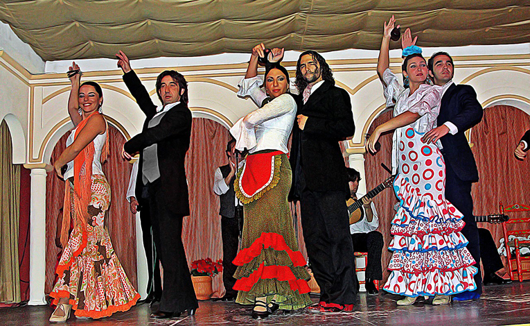 Flamenco dancers in bright patterned dresses