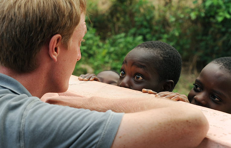 Volunteer interacting with children in Africa