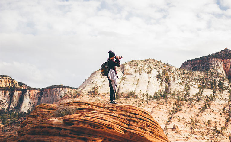 A photographer on top of a hill